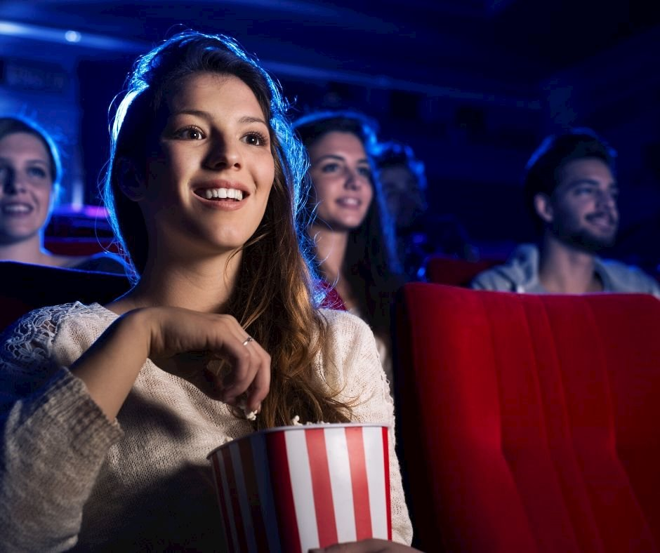 Woman at Cineplex watching movie on agilitycms.com