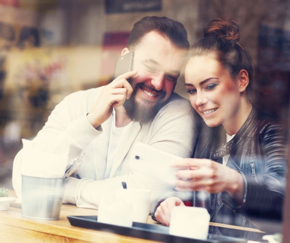 Two people taking a selfie at a café on agilitycms.com